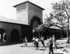 Image of art students at easels in Quad. 1950s