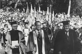 Photograph of Richard W. Lyman, Donald Kennedy, and J.E. Wallace Sterling in acadmic regalia at ceremony