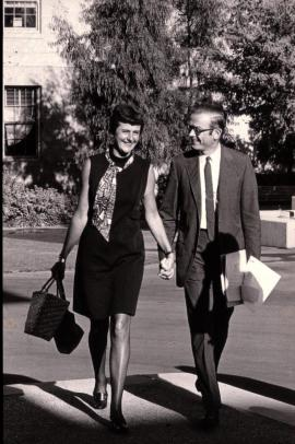 Photo of Jing Lyman and Richard W. Lyman holding hands and walking