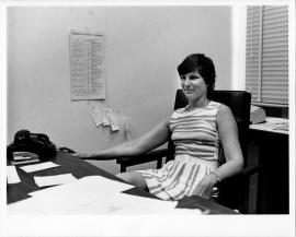 Photo of Myra Strober, when assistant professor in the Graduate School of Business, taken in 1972. Seated at desk