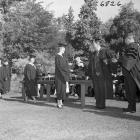 Students in line as they receive diplomas at 1957 commencement ceremony