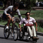 Student on bike; student in wheelchair