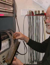 Photograph of Mark Lawrence with transmission equipment